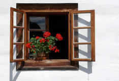 Flower decorated rural window Stock Photo