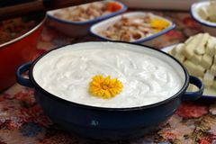Sour cream in a pot. Flower decorated sour cream in a pot Royalty Free Stock Photos