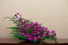 Flower Decoration. Artificial purple flower home decoration Royalty Free Stock Photography