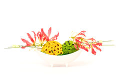 Flower decoration. Colorful table decoration with gloriosa and green and yellow chrysanthemums royalty free stock photos