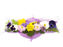 Flower decoration. Different kind of flowers on purple leaves Stock Photo