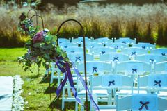 Hinged flowers decorating the pathway - outdoor wedding stock photography