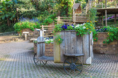 Flower decoration carriage in the garden Royalty Free Stock Image