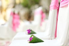 Flower decoration chair on beach Stock Images