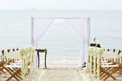 Flower decoration chair on beach wedding venue Royalty Free Stock Photography