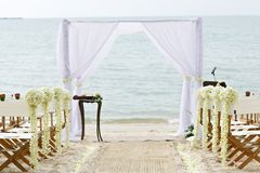 Flower decoration chair on beach wedding venue Stock Image