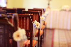 Flower decoration on chairs at wedding reception Royalty Free Stock Photography