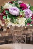 Flower decoration composed of red, violet, magenta, white flowers and green leaves. Flower decoration composed of red, violet, magenta, white flowers and green royalty free stock photo