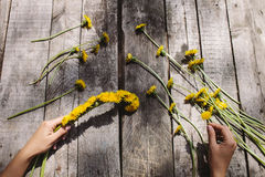 Flower decoration of dandelions and flowers handmade on wood tab Stock Photos