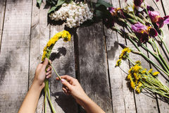Flower decoration of dandelions and flowers handmade on wood tab Royalty Free Stock Photo