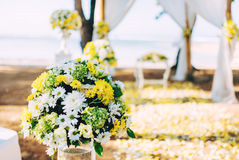 Flower decoration, details at beach wedding set up. Romantic and private ceremony of bride and groom Stock Image