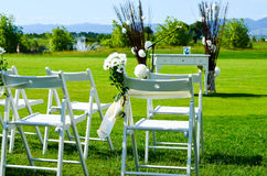 Flower decoration at an outdoor wedding Stock Photos