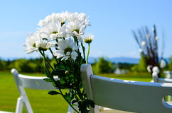 Flower decoration at an outdoor wedding Royalty Free Stock Photo