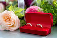 Flower decoration and a ring set on gray wedding car bonnet. royalty free stock image