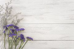 Flower decoration on wood table with panel banner Royalty Free Stock Photo