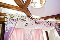 Flower decorations in the restaurant for wedding celebration. Stock Photo