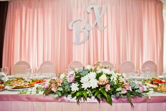 Flower decorations in the restaurant for wedding celebration. Stock Photos