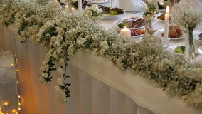 Flower decorations on the wedding tables stock video