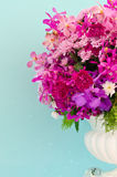 Flower decorative on a background of light blue wall. Background Stock Photo