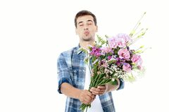 Flower delivery. Guy with bouquet of flowers isolated on white. Mock up and copy space. Happy birthday. Valentine and mother day.  royalty free stock photos