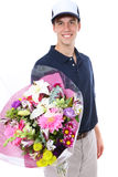 Flower Delivery Man. A handsome young man delivering flowers isolated over white stock photo