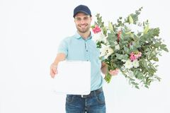 Flower delivery man showing clipboard Stock Images
