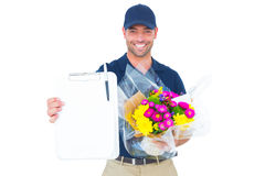 Flower delivery man showing clipboard Royalty Free Stock Photography