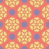 Flower design seamless pattern. Bright yellow and blue flower elements on salmon red background Stock Images