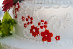Flower Details of Wedding Cake. A close up of red flowers on a wedding cake royalty free stock photos