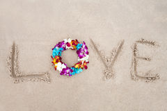 Flower diadem on the sand Stock Images