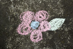 Flower drawing. Flower drawn with chalk on asphalt royalty free stock images