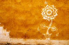 Flower at the dried clay wall, India Stock Photos