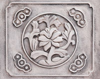 Flower engraved on stone Stock Photos