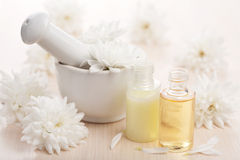 Flower essential oil and mortar. White flower essential oil and mortar stock images