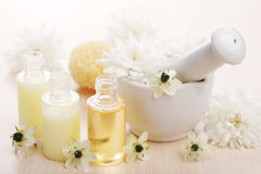 Flower essential oil and mortar. Closeup of flower essential oil and mortar stock images