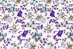 Flower on fabric background, blue colour. Stock Photography
