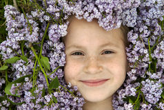Girl freckles and flowers Stock Photo