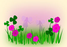 Flower Fairies. Two fairies in a meadow with pink flowers Stock Photo