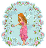 Flower fairy. Fairy standing in a frame of flowers Royalty Free Stock Image