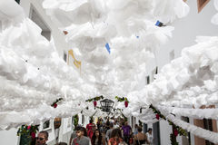 Flower festival in Campo Maior, Portugal. CAMPO MAIOR, PORTUGAL -23 AUGUST 2015: Flower festival in Campo Maior with hundred of visitors walking by paper flowers Stock Photo