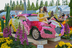Flower festival, car made of flowers with animated model Stock Photo