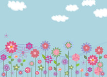 Flower field. Meadow of flowers with blue sky and clouds Stock Illustration