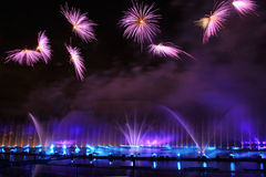 Flower Fireworks over Light Installations on Grebnoy Kanal. Painted in purple color amazing fireworks in shape of flowers over light installations on the water Stock Photo