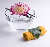 Flower floating on the Chinese sticks in bowl Stock Photo