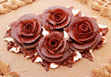 Flower Frosting. Close up of decorative flower chocolate frosting on cake stock photos