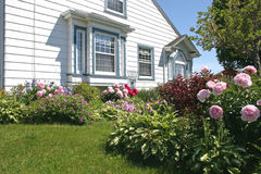 Flower Garden 1. Flower gardens on the south side of a house royalty free stock photo