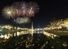 A flower garden with Beautiful Fireworks for celebration at twil. Ight time in Bangkok, Thailand Stock Images