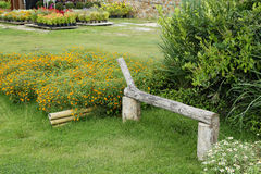 Flower garden with bench. Bench in the flower garden Stock Photo