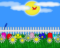 Flower Garden on a Bright Sunny Day. Colorful flower garden with white picket fence, couple of birds, and bright sun and clouds on beautiful blue sky background Stock Photo
