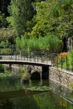 Flower garden on the edge of a small canal stock photos